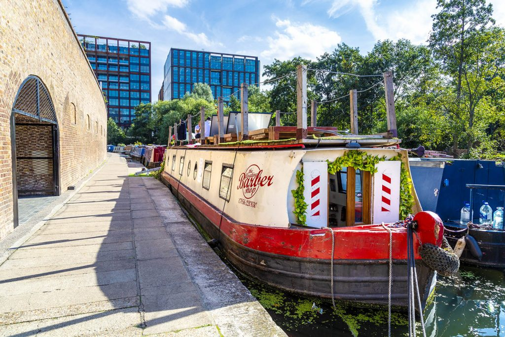 The Floating Barber Barge moored in Kings Cross on the Regents Canal, London, UK