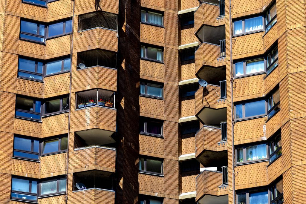Close-up of the red brick facade of a tower block in World's End Estate, London, UK