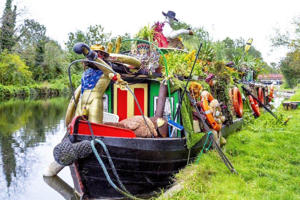 A quirky, decorated barge houseboat along the Grand Union Canal in Colne Valley, Uxbridge