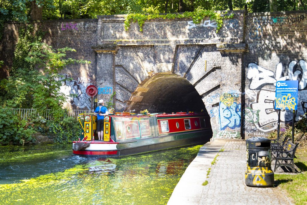 A narrowboat entering the Islington Tunnel on Regent's Canal, London