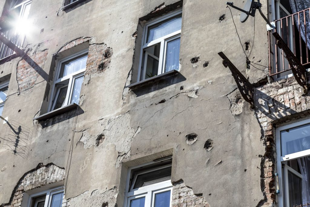 Bullet holes in a building facade remaining from the World War II Warsaw Uprising in Praga, Warsaw, Poland