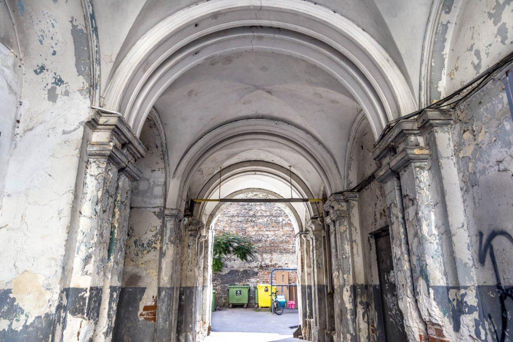 A run-down arched passageway in a tenament house near Mala Street in Praga district, Warsaw, Poland