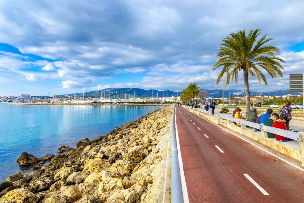 Cycling highway along the coast in El Molinar suburb of Palma, Mallorca, Spain