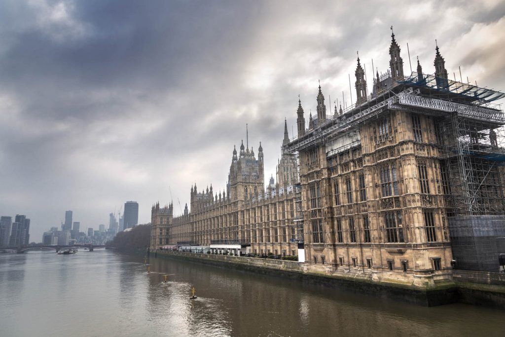 Houses of Parliament shrouded in mist, London, UK
