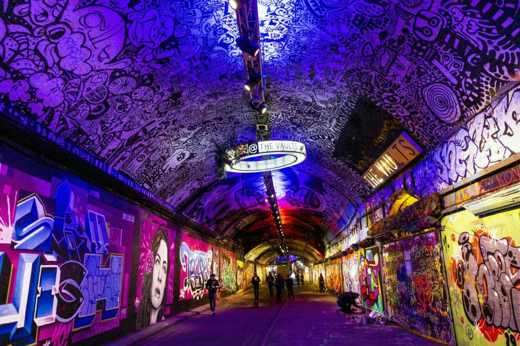 Colourful artwork and murals inside the Leake Street graffiti tunnel, London, UK