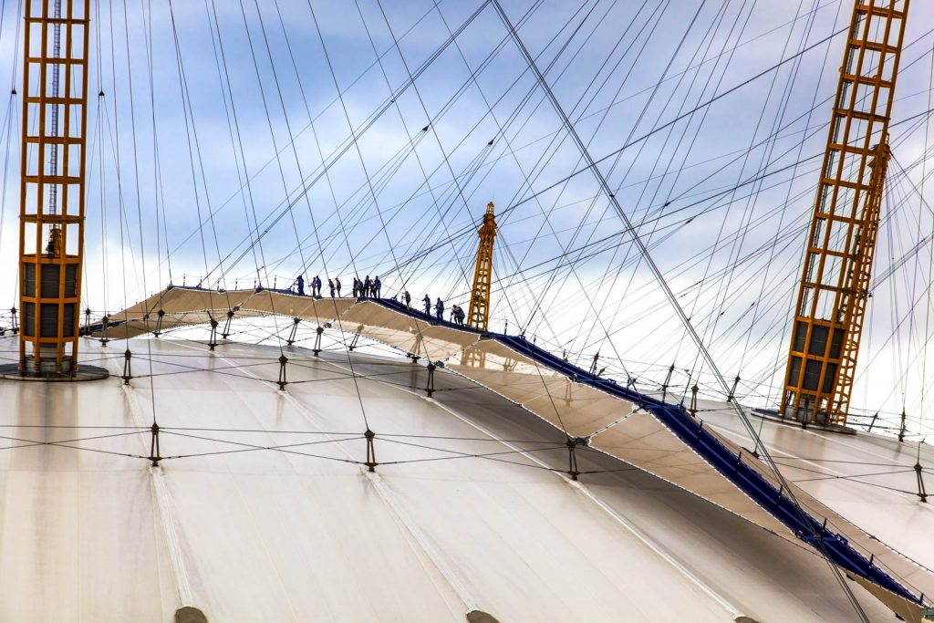 People climbing the O2 Arena, London, UK