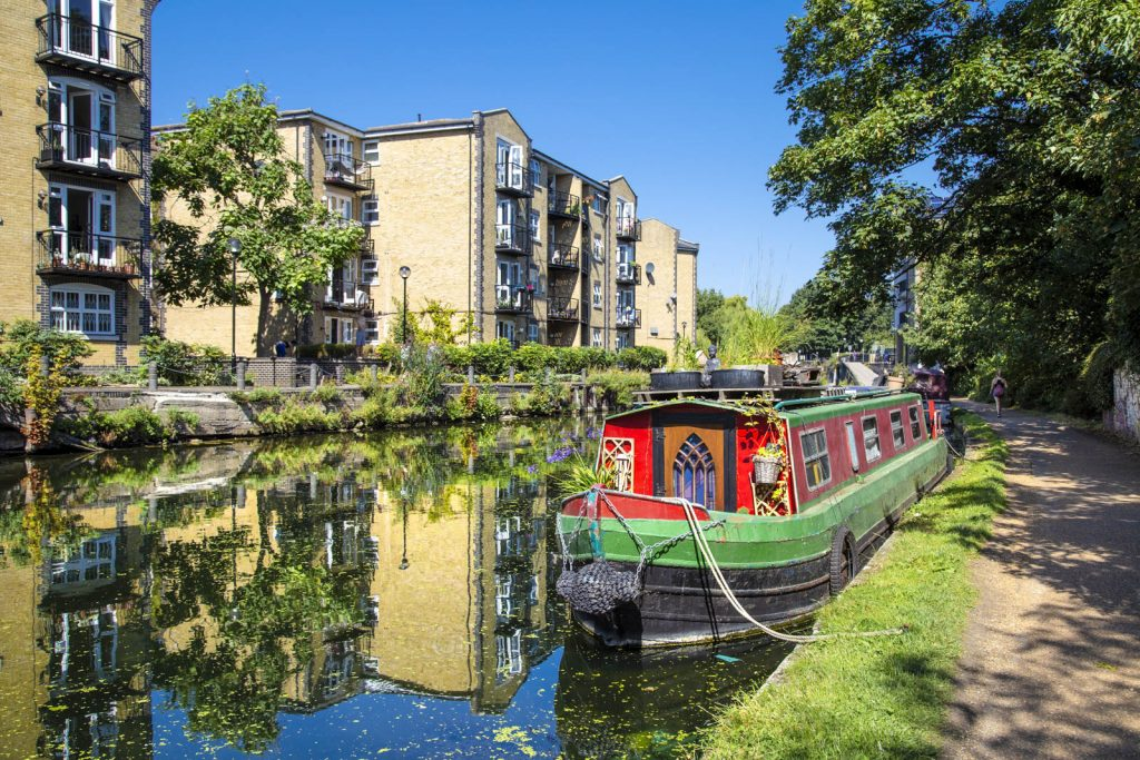 A colourful narrowboat mooring on the Regents Canal near Mile End and Victoria Park, London, UK