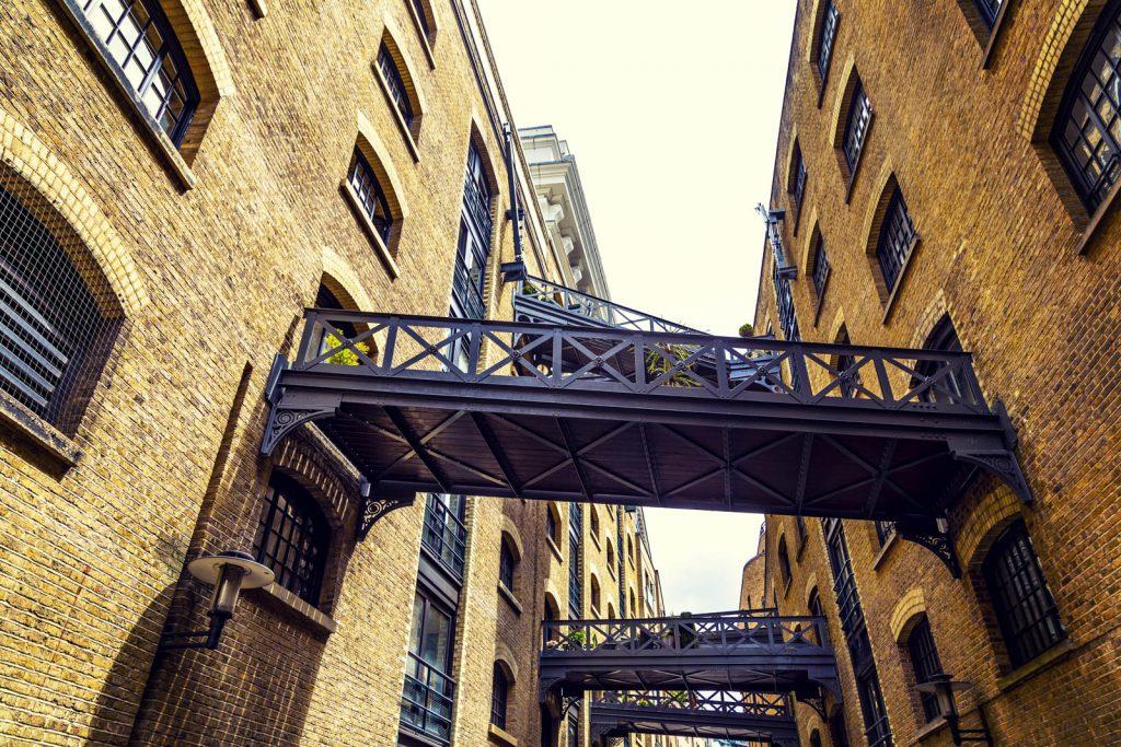 Warehouses and walkways on the historic riverside street Shad Thames, London Bridge, London, UK