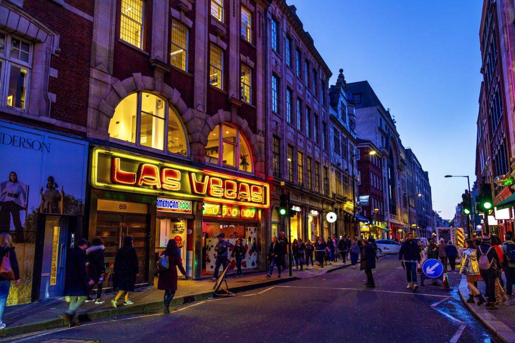 Wardour Street in the evening and Las Vegas amusement arcade in Soho, London, UK
