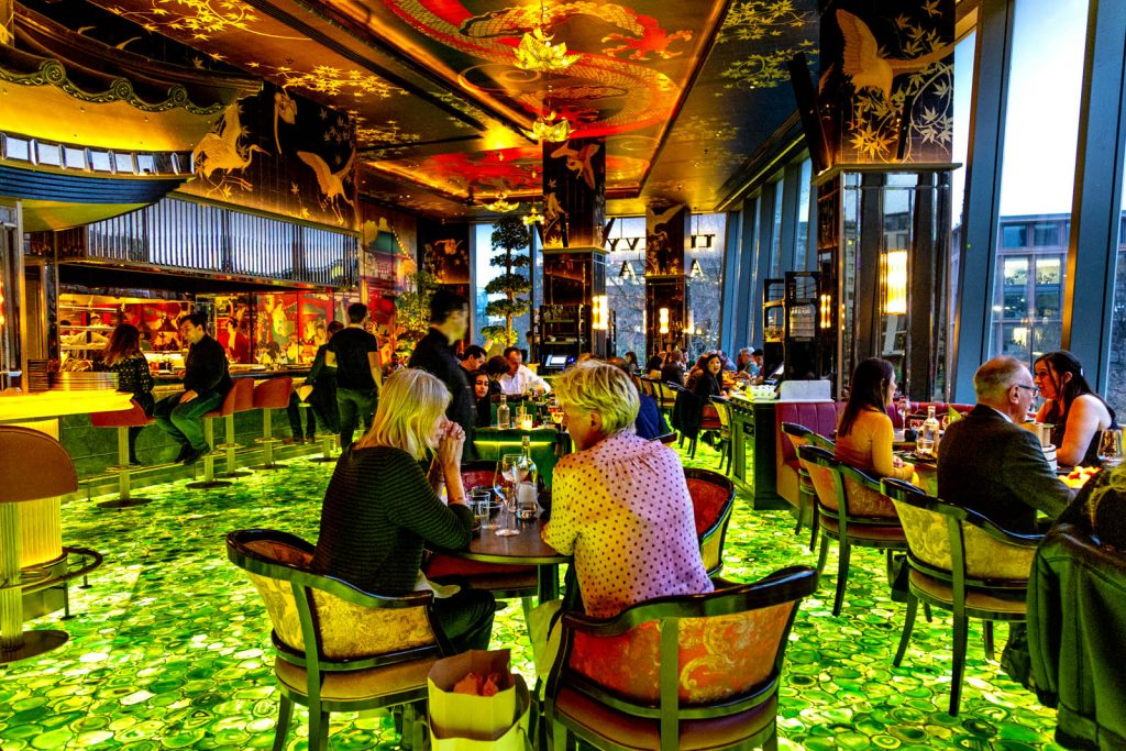 Opulent colourful interior of the Ivy Asia restaurant in St Pauls, London, UK